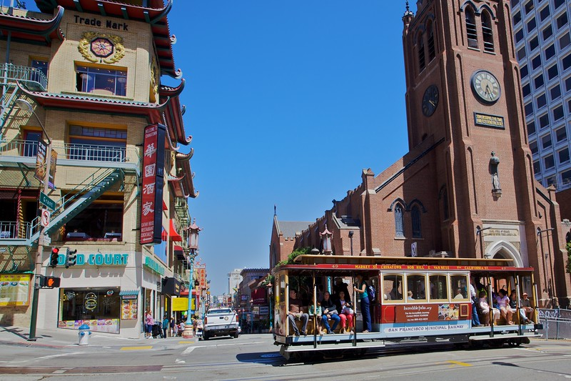 A street car passes the old cathedral (the 'Grace Cathedral') in San Francisco's Chinatown.