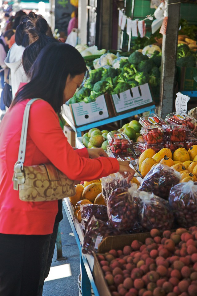 Buying fruit at a 'real' Chinese grocery in Chinatown in San Francisco.