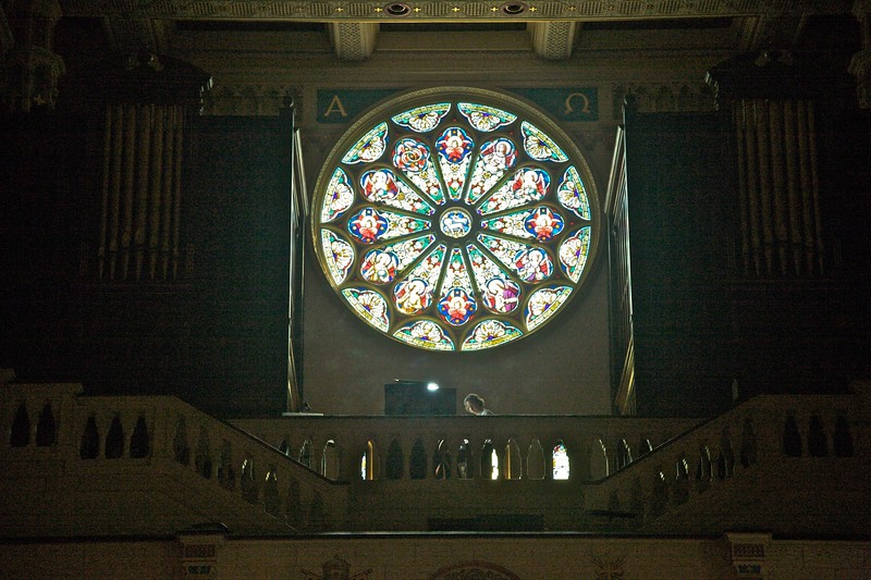 Below this stained-glass window in the church of Sts Peter and Paul, you can see an organist practising in anticipation of her recital the following evening.