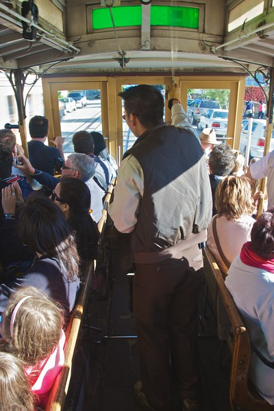 On board the cable car in San Francisco. The job of piloting the cable cars requires a great deal of physical strength, as the driver must pull the handle to exactly the right angle in order to grip the subterranean cable just enough for the car to travel smoothly.
