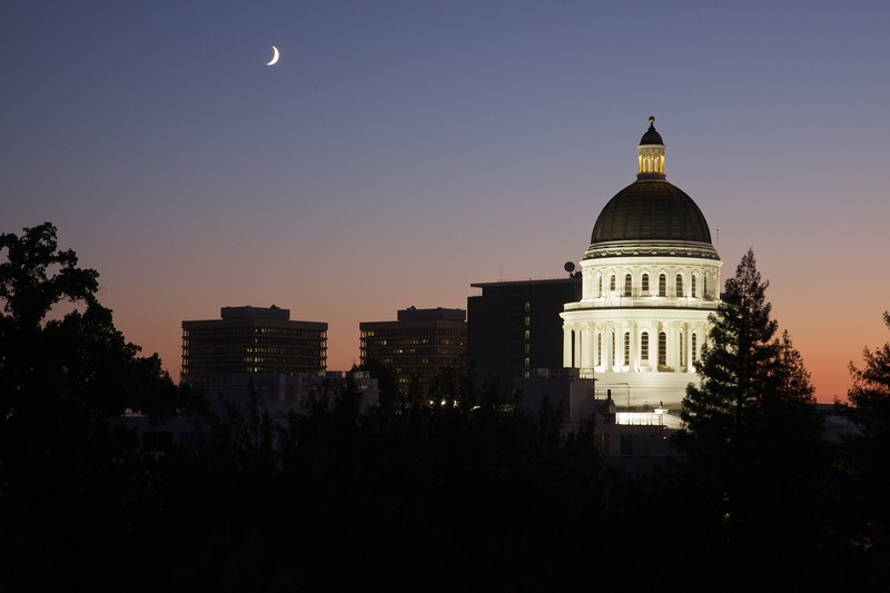 The California State Capitol building in Sacramento at dusk.