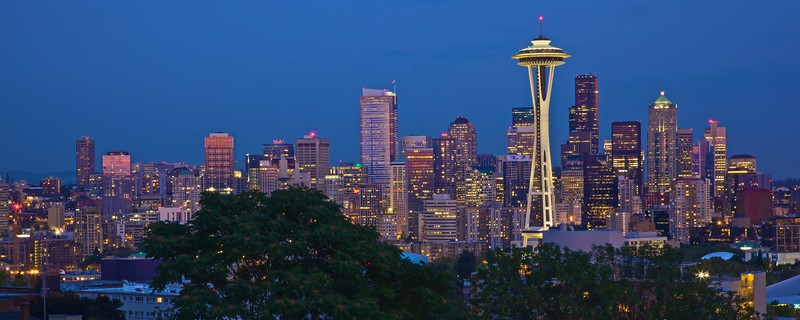 The lights of the Seattle skyline at dusk, including the Space Needle, as seen from Kerry Park. It has been theorized (but not confirmed) that the backdrop of the view from Frasier's apartment in the fictitious Elliott Bay Towers was photographed from this point.