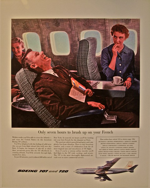 'Only seven hours to brush up on your French': a poster advertising the benefits of Boeing's first two passenger jet aircraft, the 707 and 720 (as seen at the Museum of Flight, Seattle).
