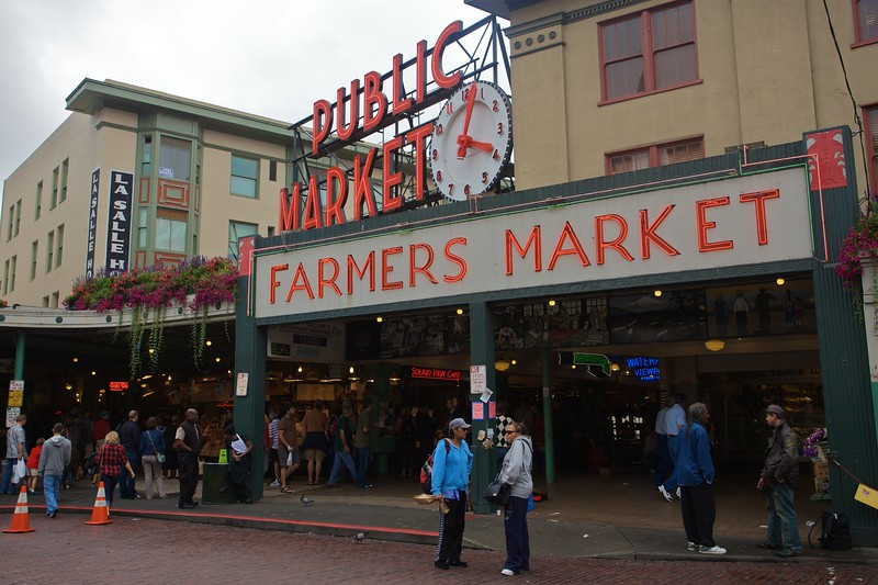 Tourists outside the main entrance to Pike Place Market in Seattle.