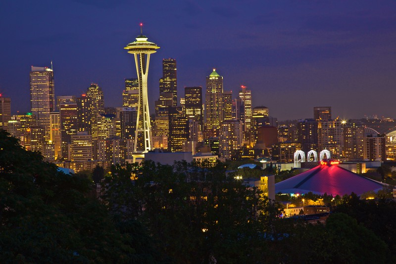 The lights of the buildings of Seattle, including the Space Needle and the KeyArena (home court of Seattle's basketball team).