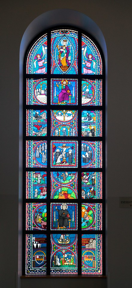 The left window of the two stained-glass windows inside the main entrance of St Louis' Priory School.