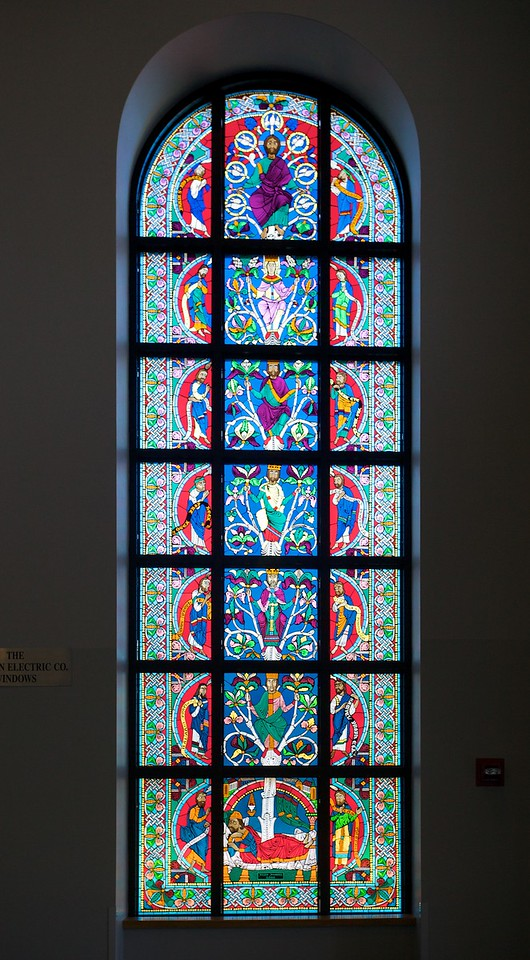 The right window of the two stained-glass windows inside the main entrance of St Louis' Priory School.