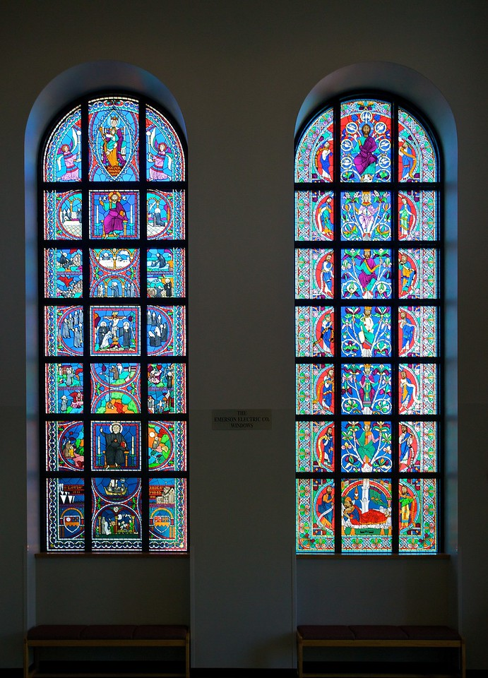 These stained-glass windows are just inside the main entrance to St Louis' Priory School. They depict the ancestry of the foundation, ending with the voyage of monks from Ampleforth to Missouri to establish the Priory, and stretching back, via stories of St Benect, to Mary, Mater Monachorum.<br /> (Close-ups of the two windows follow.)