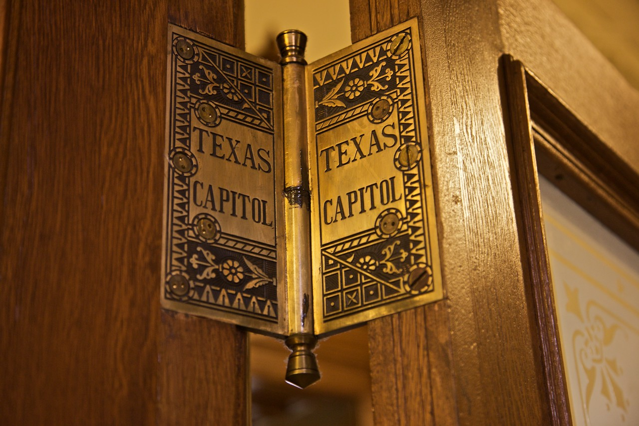 Each of the doors in the Texas Capitol is attached by three of these specially carved brass hinges, each one weighing about 8 lb.