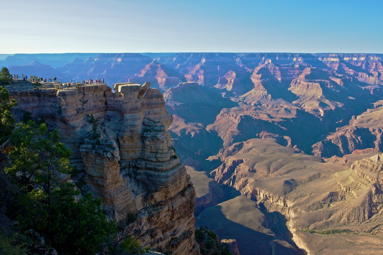 Tourists looking over the Grand Canyon.