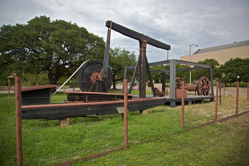 The University of Texas at Austin is apparently one of the richest universities in the world, and consequently has been able to purchase many rare artefacts and manuscripts. The university's wealth is a result of the fact that it owned an oil reserve which was drilled during the 20th century. This is the pumping equipment that was used (Santa Rita No. 1), moved to a location near to the UT Austin campus from the well, which was near Big Lake, Texas.