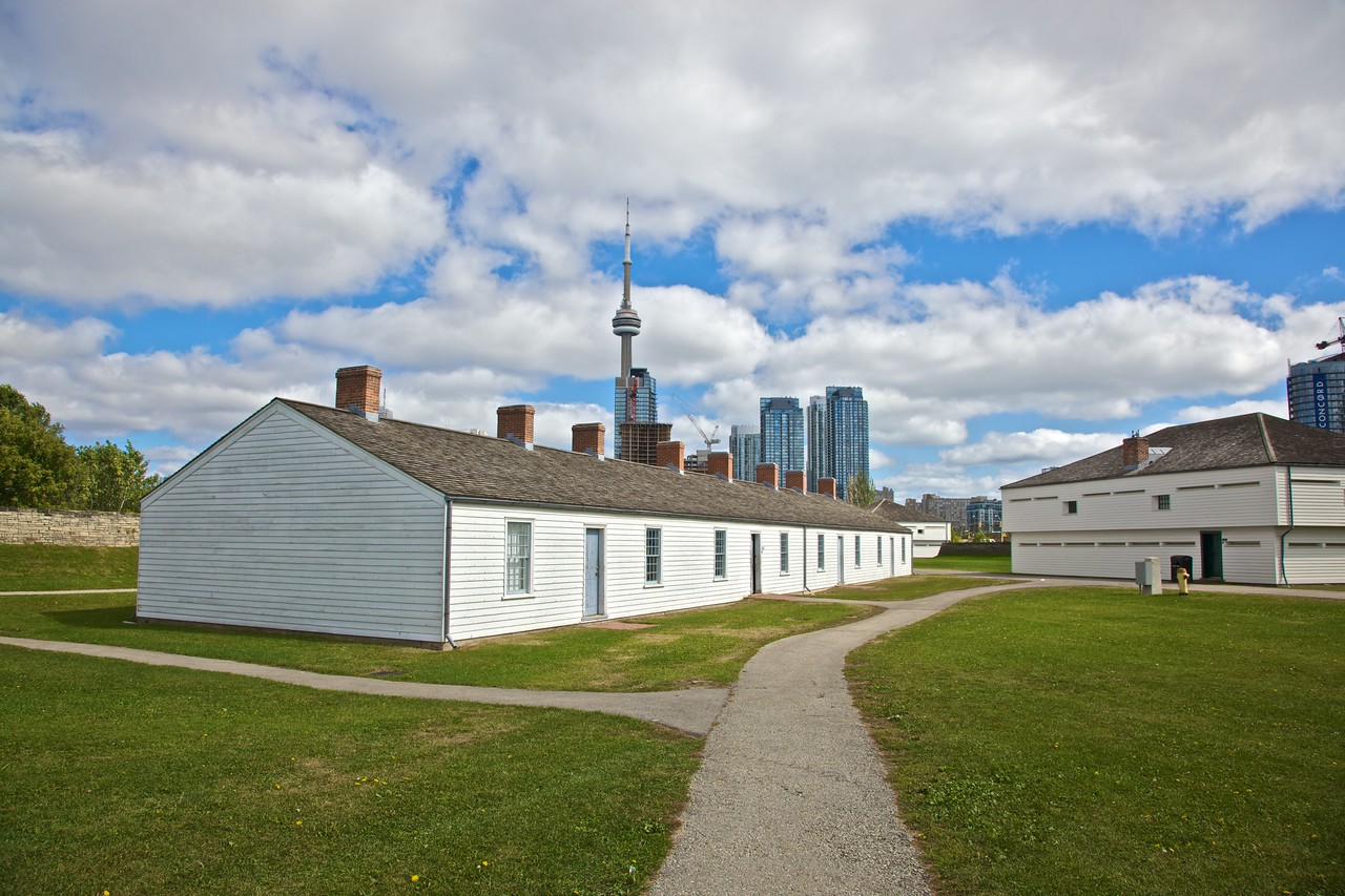 Some of the buildings of Fort York, with part of the Toronto Skyline visible (most prominently the CN Tower) behind.