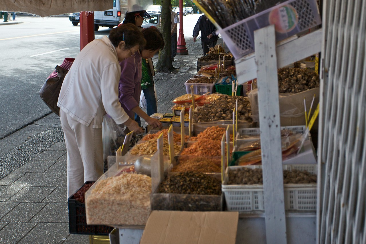Ladies shopping for stinky dried goods at a merchant in Chinatown in Vancouver.