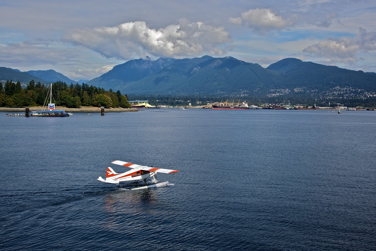 A seaplane lands on Burrard Inlet (Vancouver harbour).