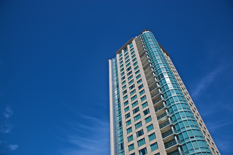 One of the many glass-and-concrete buildings in Vancouver rising up in to the sky.