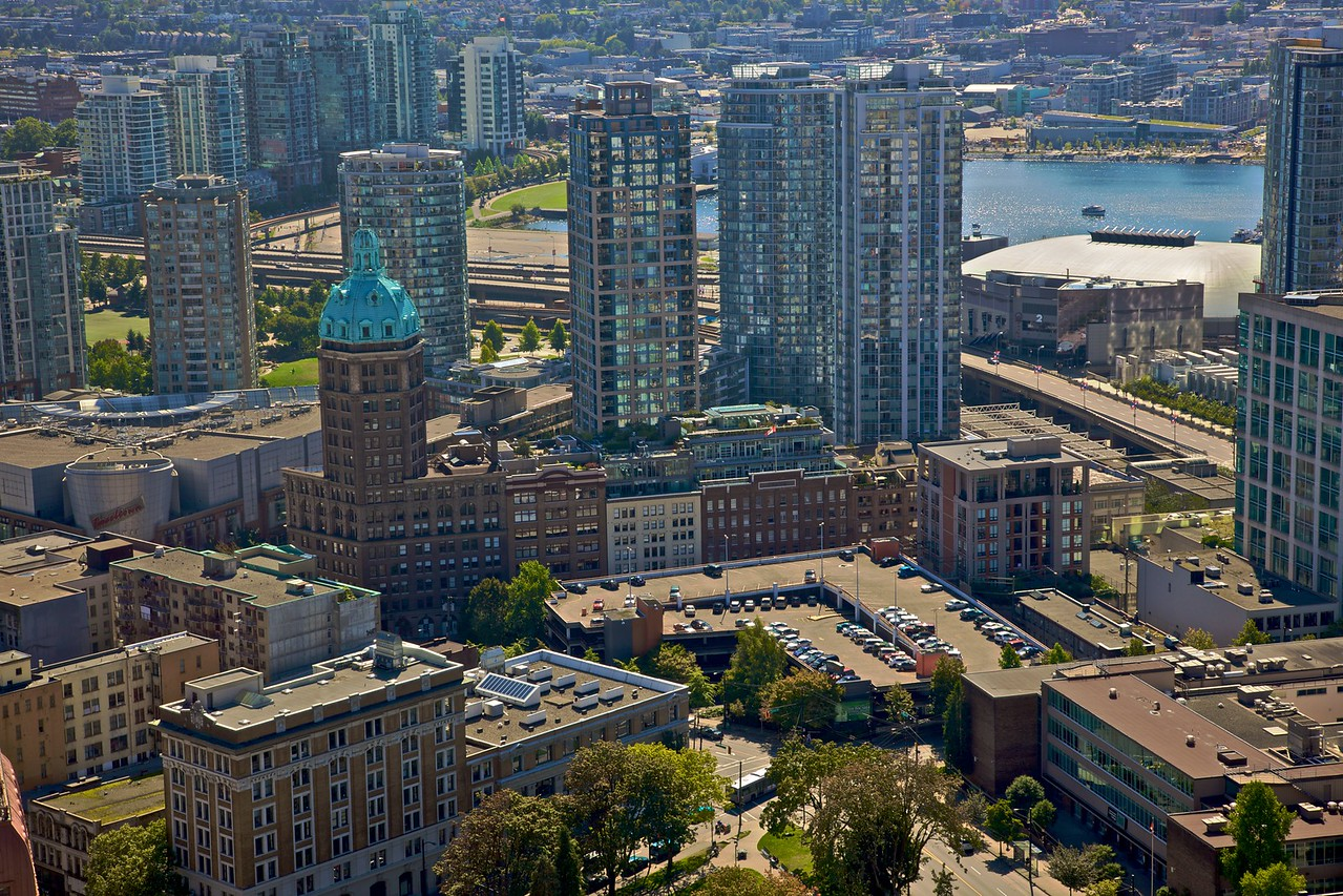 The buildings of downtown Vancouver as seen from the Harbour Centre building. The building with the copper dome is the Sun Tower, which was built for the <cite>Vancouver World</cite> newspaper in 1911–12. For a time it was the tallest building in the British Empire.