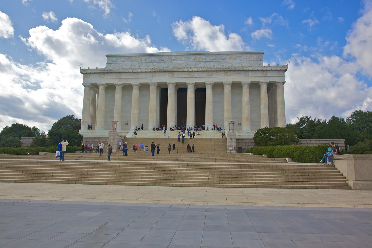 Tourists on the steps of the Lincoln Memorial.