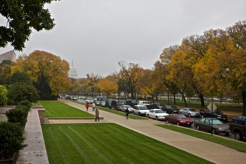 Walking in the rain outside the National Gallery of Art. You can see the National Capitol building in the distance.