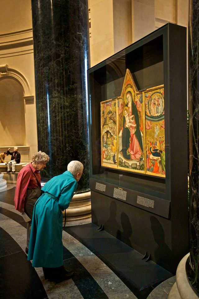 In the National Gallery of Art, two woman peer at The Beffi Triptych, which is from the National Museum of Abruzzo in L'Aquila, and was lent to the National Gallery of Art by the Italian government in gratitude to the U.S. for its assistance following the earthquake in L'Aquila earlier in the year. The National Museum of Abruzzo was so damaged by the earthquake that the building was condemned.