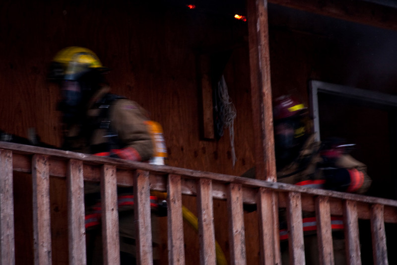 Lieutenant Tara Mellon (right) and another firefighter work hard and fast to get the fire under control.