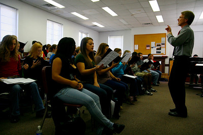 The Gardner-Webb University Choir rehearsing for the upcoming Festival of Lights Concert.  Dr Etter instructs the students on proper diction and style.  This year is the largest the Concert Choir has ever been.