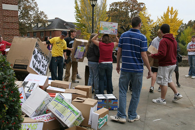 "Students of German and French prepare to haul their now demolished ""Berlin Wall"" to the recycling bins."