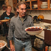 Tribune-Star/Joseph C. Garza<br /> Cranberry crew: With the turkey carved and set out on a pool table at Club Soda, member Jerry Wilkey just had one more item to bring in from the refrigerator and that being the cranberry sauce Thursday at the recovery club.