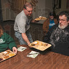 Tribune-Star/Joseph C. Garza<br /> Hot plate: Lighthouse Mission volunteer Chad Bond of Vincennes serves a hot Thanksgiving meal to resident David Reynolds after giving one to Reynolds' sister, Star Kerley, Thursday at the mission.