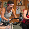Laugh through the burn: Turkey Burn participants Charity Kester and Mandy Harrison laugh through the burn of a cycling class at the Terre Haute Family Y Thursday morning.