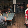 Tribune-Star/Joseph C. Garza<br /> A song of thanksgiving: Lighthouse Mission volunteer Kathleen West sings the song, I Thank You, Lord, as patrons enjoy their Thanksgiving Day meal Thursday at the mission.