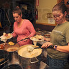 Tribune-Star/Joseph C. Garza<br /> With all of the fixings: Brandy Walker fills her plate with several of the sides as a member by the name of Rebecca does the same at the beginning of the Club Soda Thanksgiving dinner Thursday.
