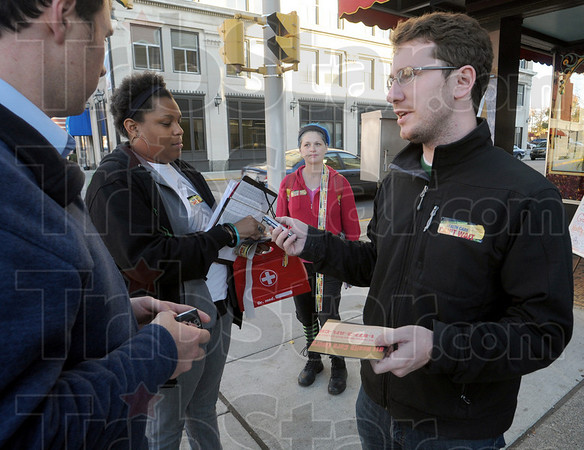 """Organizer: Dan O'Malley (R), director of the Indiana office of Working America talks with fellow workers at 7th and Wabash Thursday afternoon. They provided a cell phone and number to anybody that wanted to call their congressman or senator to push for health care legislation with the """"public option."""""""