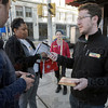 "Organizer: Dan O'Malley (R), director of the Indiana office of Working America talks with fellow workers at 7th and Wabash Thursday afternoon. They provided a cell phone and number to anybody that wanted to call their congressman or senator to push for health care legislation with the ""public option."""