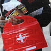 "First aid: A Working America volunteer carries a first aid kit and literature about the ""public option"" plan being considered by congress. They offered cell phones and numbers to anybody that wanted to call their congressman or senator and ask him to vote in favor of the ""public option"" plan."