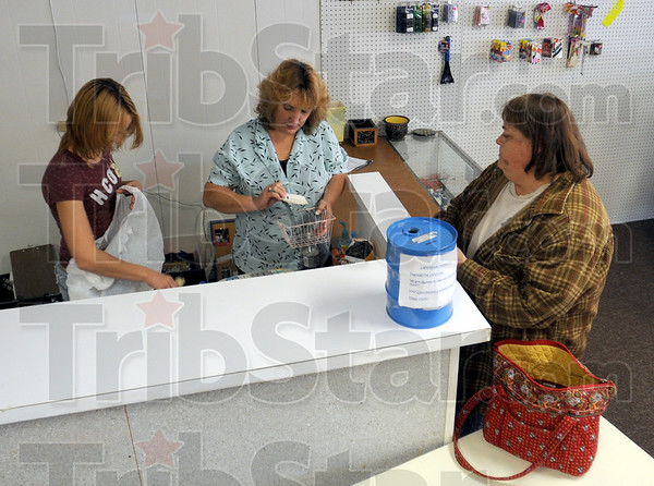 Check-out: Thrift store employees Connie Coleman and Mary Fagg check-out the items being purchased by Edie Porter Thursday afternoon.