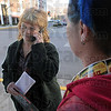 Caller: Terre Haute resident Sandy Swift puts in a call to Brad Ellsworth's office Thursday afternoon at seventh and Wabash using a cell phone provided by Bonnie Schafman (R) of Working America.
