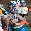 Tribune-Star/Joseph C. Garza<br /> Blocking for the running play: Rockville center James Kent blocks a teammate for a running back during team practice Wednesday in Rockville.