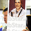 Back to the future: Leo Finnerty holds a picture of what George Rogers Clark looked like at age 26. The image was created using a portrait of Clark at age 64 and doing a reverse aging process.