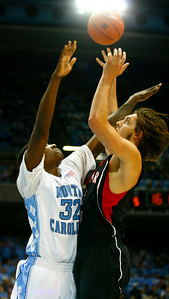 Auryn MacMillan receives immense pressure from Chapel Hill's Ed Davis.  Size was a major difference between the two teams.