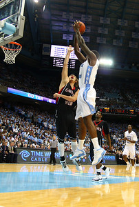 GWU's Auryn MacMillan, one of the tallest players, even had a hard time keeping UNC grounded.