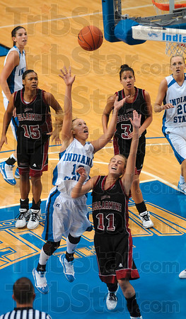 Tribune-Star/Joseph C. Garza<br /> Inside game: Indiana State's Deja Mattox shoots over Bellarmine's Rachel Greenwell during the Sycamores' win Sunday at Hulman Center.