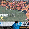 Tribune-Star/Joseph C. Garza<br /> One for the scrapbook: Georgia State cross country runner Janel Blancett poses for a photograph taken by coach Chris Woods Sunday in front of the NCAA Division I Championship billboard on Indiana 42.