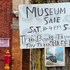Tribune-Star/Joseph C. Garza<br /> On the right track: A sign on a tree outside of the Fire and Police Museum alerts passers-by of a sale Sunday at the museum to help raise funds for the building.
