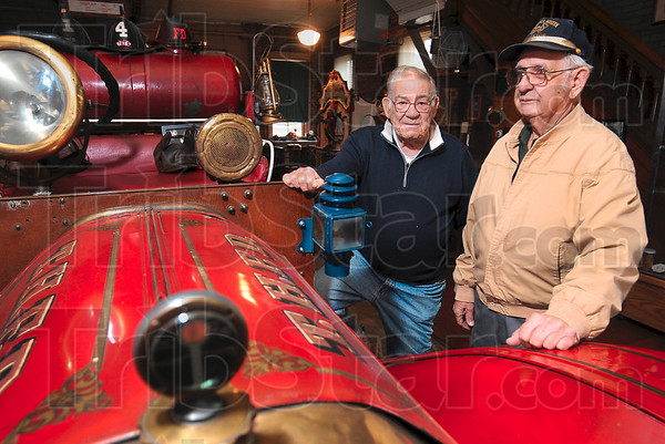 Tribune-Star/Joseph C. Garza<br /> Local history: Danny Budd and Tom Champion, assistant and curator, respectively, of the Fire and Police Museum at 1728 S. Eighth Street, tried to raise funds for the museum with a sale of train books and videos over the weekend.