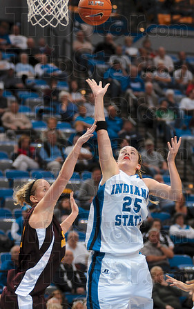 Tribune-Star/Joseph C. Garza<br /> Two right by you: Indiana State's Chelsea Buher shoots for two points over a Central Michigan defender during the Sycamores' 76-57 win Sunday at Hulman Center.