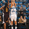Tribune-Star/Joseph C. Garza<br /> Schoen's a shooter: Indiana State's Brittany Schoen shoots for three of her team high 17 points over Central Michigan's Shonda Long during the Sycamores' 76-57 win Sunday at Hulman Center.