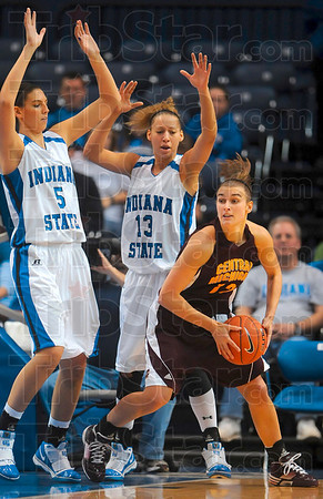 Tribune-Star/Joseph C. Garza<br /> Where the trees are too tall: Indiana State's Shannon Thomas and Deja Mattox deny Central Michigan's Britni Houghton any opportunity to the basket Sunday at Hulman Center.