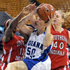 Whack job: Indiana State's 350, Laurence Rivest gets whacked across the arms as she drives the ball to the hoop during Sunday's game against Southern Indiana.