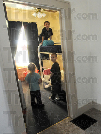 Child's play: Peggy Wesley-Fitzthum's kids and her brother's kids try out the bunk beds in their Clinton home Sunday afternoon.
