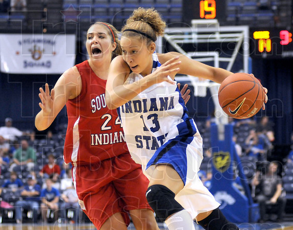 Help: Southern Indiana's #24, Lauren Meneghetti yells for assistance as ISU's Deja Mattox drives the ball past her during game action Sunday afternoon at Hulman Center.